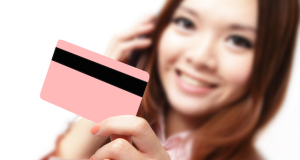 Smiling Business Woman Holding A Credit Card And Speaking Mobile Phone