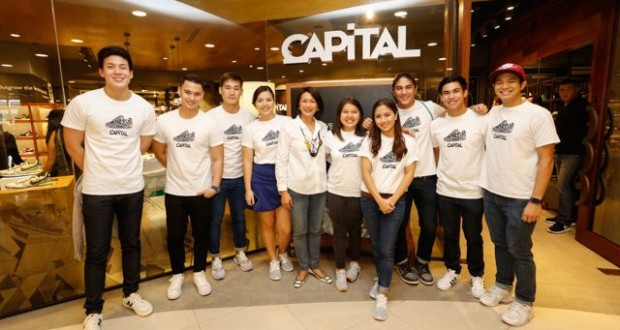 T.O.P. chairman and managing partner May Cu Unjieng (fifth from left) poses with Capital's brand ambassadors during the store's media launch.