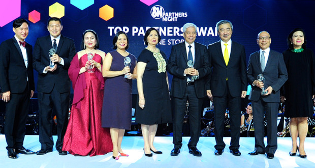 SM Prime Holdings, Inc. president Hans Sy (3rd from right), SM Supermalls president Annie Garcia (rightmost) and SVP for Operations Steven Tan (extreme left) present the SM Top Partners Awards for inline stores to Octagon in the IT category received by Jon-Jon San Agustin, Thess Manganti of Let's Face It in the Wellness category,  Xandra Ramos and Precy Ramos of National Bookstore in the Specialty category, Virgilio Lim of Bench in the Fashion category, and William Tan of Jollibee in the Food category during the first SM Partners Night at the SMX Convention Center in celebration of SM Supermalls' 30th anniversary.