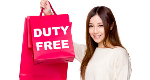 Young Woman hold with shopping bag showing duty free